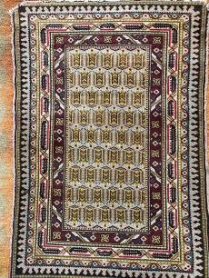 Élénk színű perzsa kézi szőnyeg
